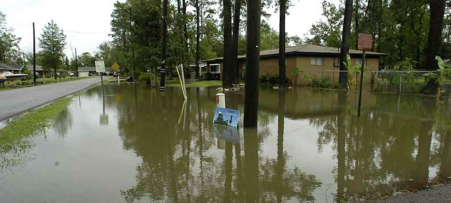 Last year's bouts of National Flood Insurance Program's expirations and reauthorizations and this year's floods in the Mississippi and Missouri rivers are putting more strain on the flood program that is overextended by billions of dollars. Dave Ryan/The Enterprise Photo: Dave Ryan