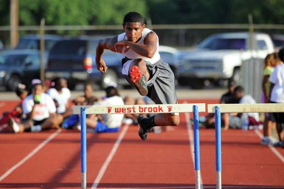Beaumont Track Club hurdler Ian Bramble works on his approach during workouts on Thursday with members of the track club at West Brook High School. Bramble will be attending Central as a freshman in the fall.  June 16, 2011.  Valentino Mauricio/The Enterprise Photo: Valentino Mauricio