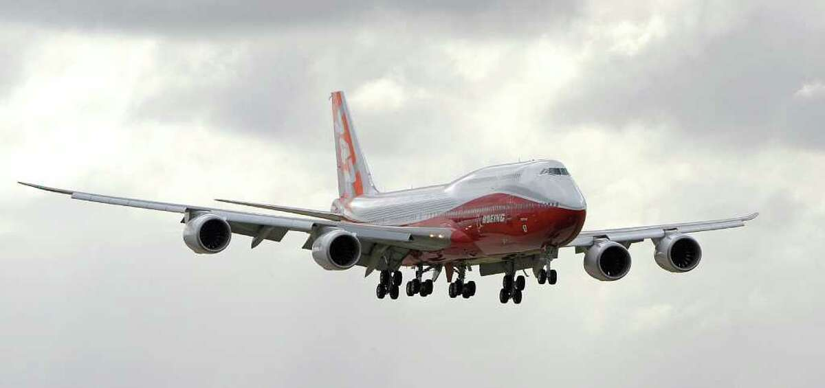 The new Boeing 747-8 Intercontinental lands at Le Bourget airport near Paris on June 19, 2011.