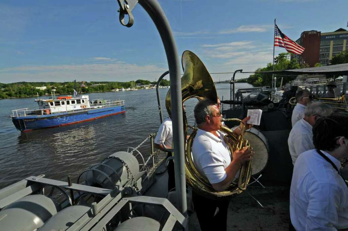 Yankee Doodle Band tuba player Bill Lindemann of Castleton plays Sunday on the USS Slater after a National Maritime Day ceremony on the boat in Albany. ( Philip Kamrass / Times Union)