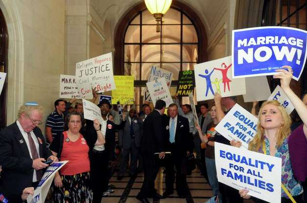 Protesters for and against the same-sex marriage bill protest in the halls at the Capitol in Albany, N.Y., Monday, June 20, 2011, as Senate Republicans, who can determine the measure's fate, consider whether to schedule a decisive vote on the issue. Photo: Hans Pennink, AP / FRE58980 AP