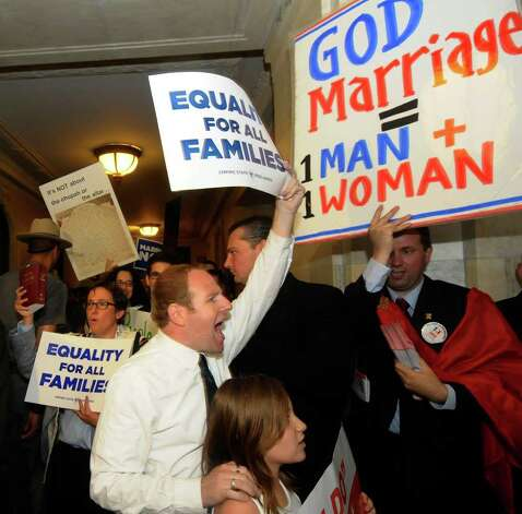 Protesters for and against the same-sex marriage bill protest in the halls of the Capitol in Albany, N.Y., Monday, June 20, 2011, as Senate Republicans, who can determine the measure's fate, consider whether to schedule a decisive vote on the issue. Photo: Hans Pennink, AP / FRE58980 AP