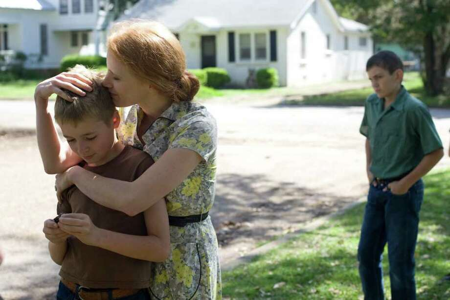 """In this publicity image released by Fox Searchlight films, from left, Laramie Eppler, Jessica Chastain, and Hunter McCracken are  shown in a scene from """"The Tree of Life."""" (AP Photo/Fox Searchlight, Merie Wallace) Photo: Merie Wallace, HONS / Fox Searchlight"""