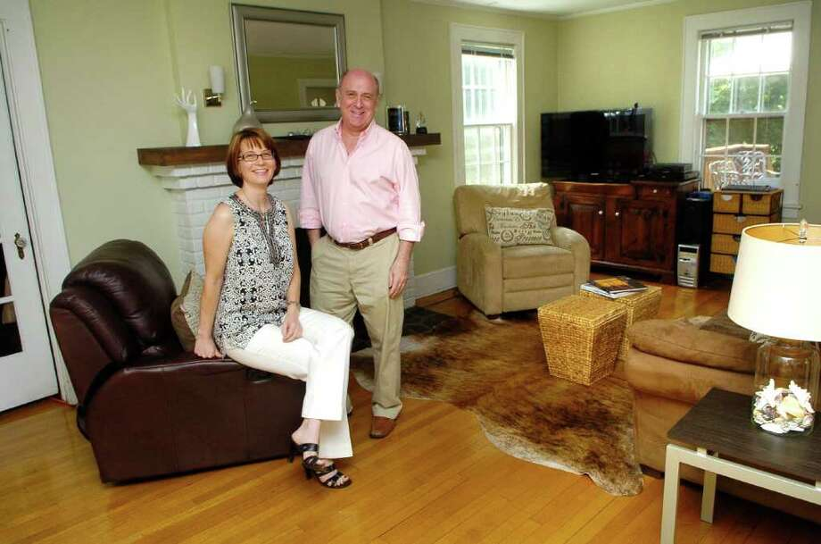 House staging partners Birgit Anich and Gary Sefferman in a room they staged in Anich's Norwalk, Conn. home on Monday June 20, 2011. Photo: Dru Nadler / Stamford Advocate Freelance