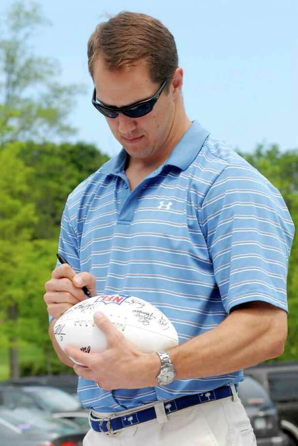 Patrick Kerney signs footballs at the NFL Alumni Connecticut Chapter 5th annual Celebrity Golf Classic at Country Club of Darien in Darien, Conn. on Monday June 20, 2011. Photo: Dru Nadler / Stamford Advocate Freelance