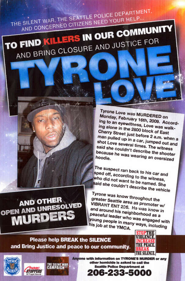 Friends and community activists post flyers Monday, June 20, 2011, to help solve the killing of Tyrone Love.