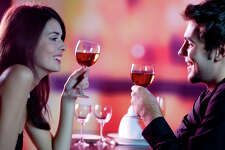 Young happy amorous couple celebrating with red wine at restaurant stock entertainment dinner dining living lifestyle wine love romance