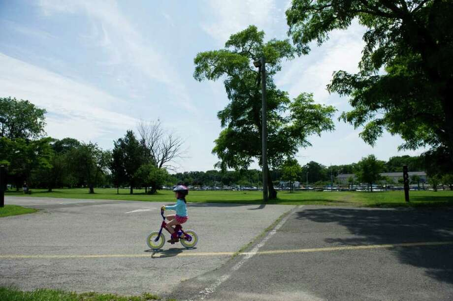 Julia Coggins, 4, rides her bike through Cove Island Park in Stamford, Conn., June 20, 2011. Photo: Keelin Daly / Stamford Advocate