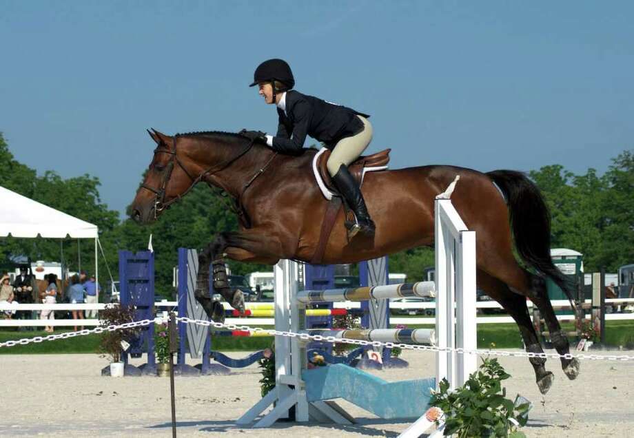Isabella Meyer from Atlanta, Georgia, in an Equitation competition at the 81st Annual Ox Ridge Horse Show on Saturday, June 18, 2011. Photo: Jeanna Petersen Shepard / Darien News