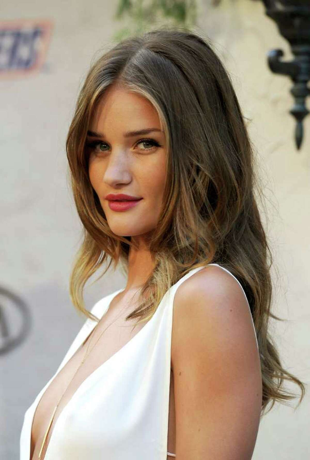 ... here's British model Rosie Huntingdon-Whitley, who replaced Fox in the latest