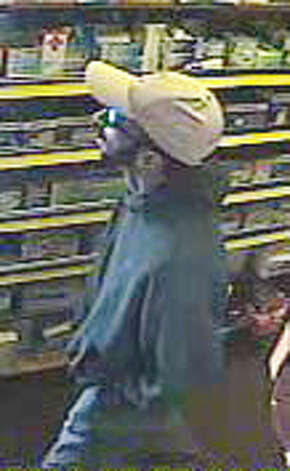 A surveillance photo released by Suffolk County Police, Monday, June 20, 2011 shows a suspect in the killings of four people at Haven Drugs in Medford, N.Y. Investigators believe that a single gunman was responsible for the shooting of two employees and two customers inside the pharmacy, Sunday, June 19, 2011. (AP Photo/Suffolk County Police)