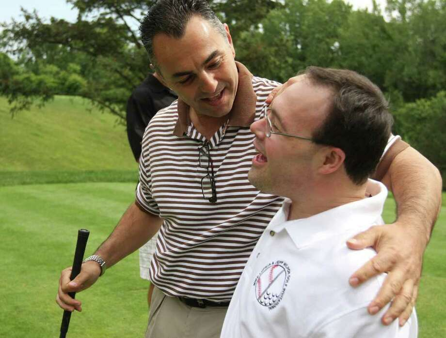 Former New York Mets ace reliever John Franco says hello to Domminick Murolo during the Mike Lupica/Fred Wilpon golf outing at Fairview Country Club in Greenwich Monday. The annual golfing event is to benefit Special Olympics.  © J. Gregory Raymond Photo: J. Gregory Raymond / Stamford Advocate Freelance