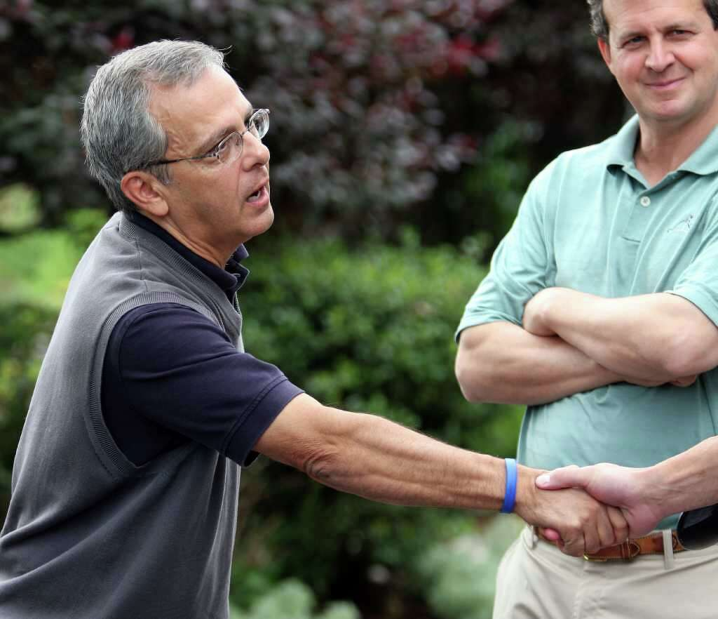 Meet the mets charity golf event supports special olympics sports journalist mike lupica greets a guest at the annual mike lupicafred wilbon golf new york mets kristyandbryce Gallery