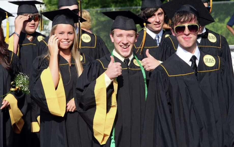 Graduate Patrick Cornelio gives a thumbs up as he enters the Jonathan Law High School Commencement ceremony in Milford on Monday, June, 20, 2011. Photo: B.K. Angeletti / Connecticut Post