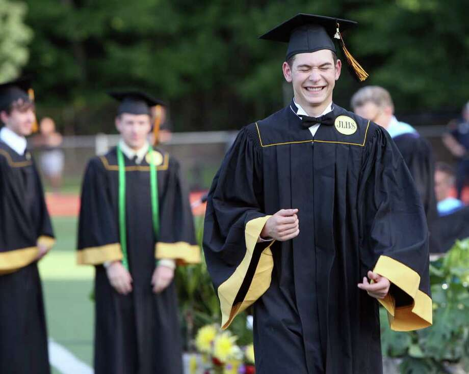 Graduate Robert Cole reacts as he walks up to receive his diploma at the Jonathan Law High School Commencement ceremony in Milford on Monday, June, 20, 2011. Photo: B.K. Angeletti / Connecticut Post