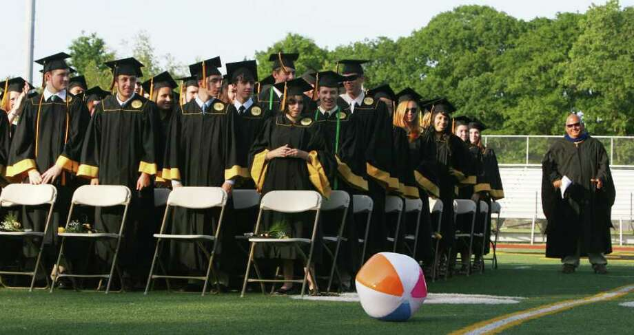 Graduates watch as a beach ball drops before it is confiscated at the Jonathan Law High School Commencement ceremony in Milford on Monday, June, 20, 2011. Photo: B.K. Angeletti / Connecticut Post