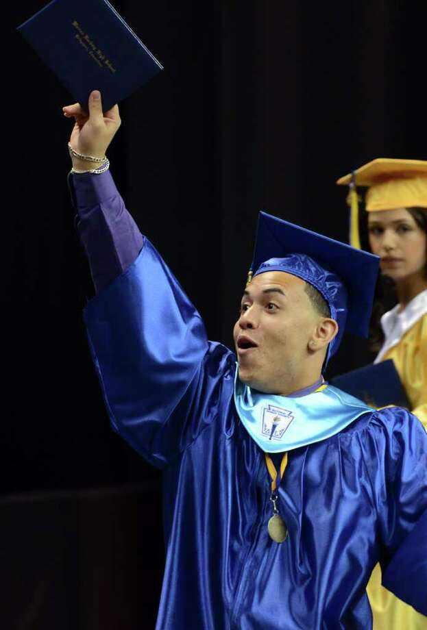 Ariam Rivera hoists his diploma in the air during the 2011 Warren Harding High School Commencement at Webster Bank Arena in Bridgeport on Monday, June 20, 2011. Photo: Amy Mortensen / Connecticut Post Freelance