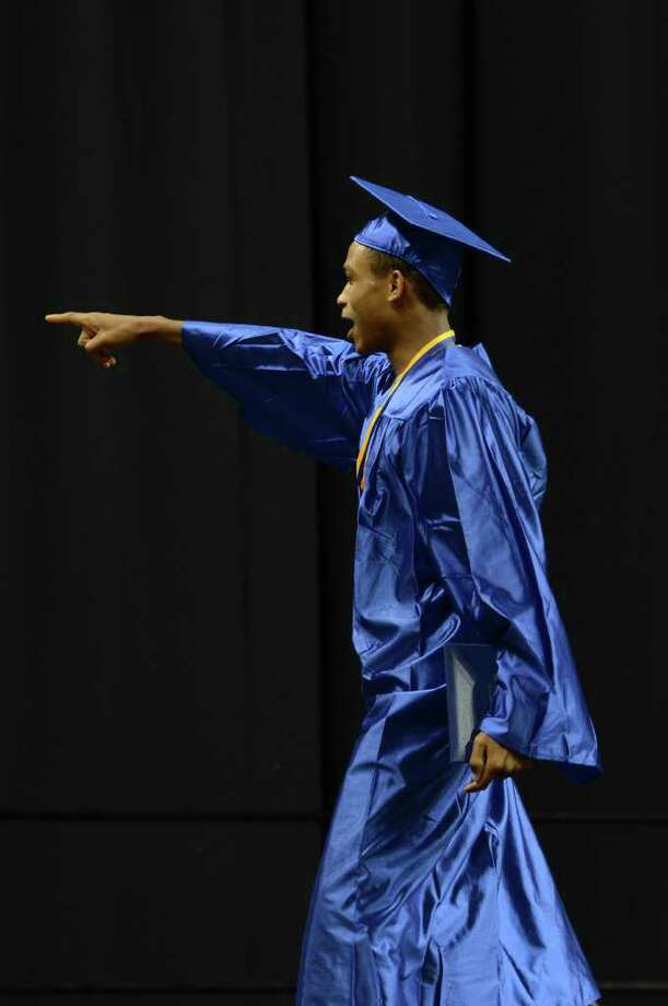 Corey Baldwin points to the audience during the 2011 Warren Harding High School Commencement at Webster Bank Arena in Bridgeport on Monday, June 20, 2011. Photo: Amy Mortensen / Connecticut Post Freelance