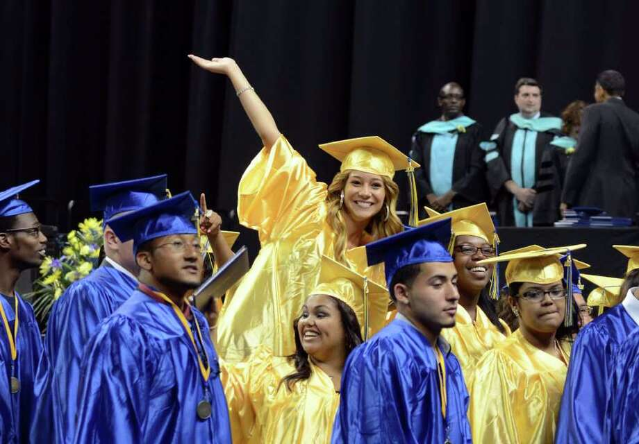Graduate Crystal O'Grinc waves to the audience during the 2011 Warren Harding High School Commencement at Webster Bank Arena in Bridgeport on Monday, June 20, 2011. Photo: Amy Mortensen / Connecticut Post Freelance