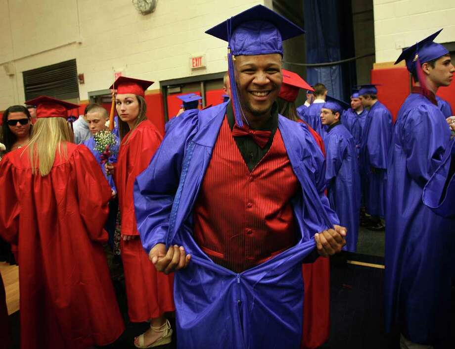 Tyreek Grant shows off his red suit and bow tie as graduates ready for the Class of 2011 Commencement Exercises at Foran High School in Milford on Monday, June 20, 2011. Photo: Brian A. Pounds / Connecticut Post