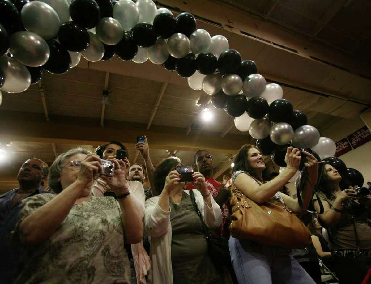 Family members jockey for position with their cameras during graduation ceremonies at Platt Technical High School in Milford on Monday, June 20, 2011.