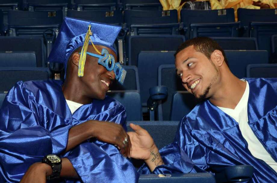 Joseph Spain, at left, shares a moment with a classmate during the 2011 Warren Harding High School Commencement at Webster Bank Arena in Bridgeport on Monday, June 20, 2011. Photo: Amy Mortensen / Connecticut Post Freelance
