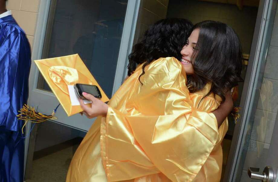 Graduates share a moment during the 2011 Warren Harding High School Commencement at Webster Bank Arena in Bridgeport on Monday, June 20, 2011. Photo: Amy Mortensen / Connecticut Post Freelance