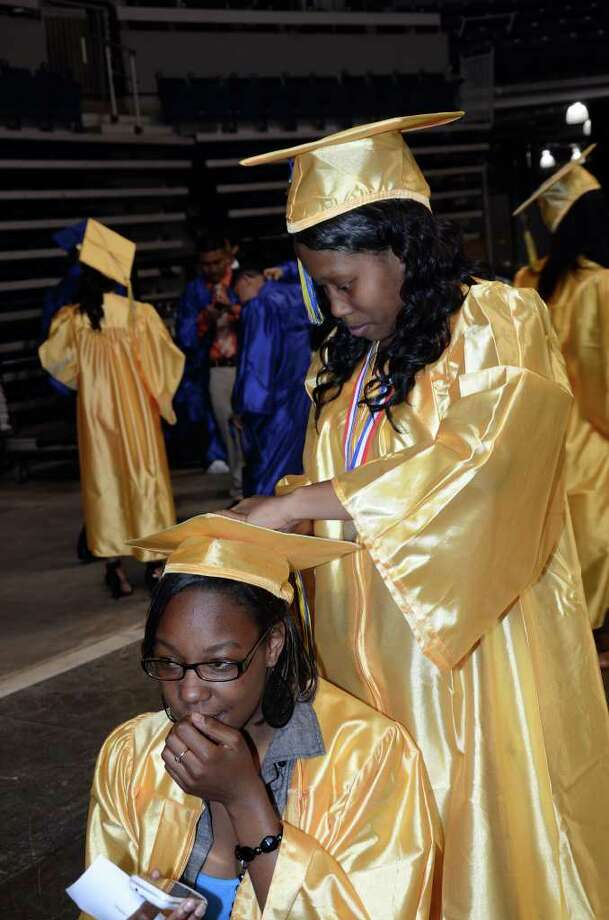 Tangela Cochran places the tassle on Kyra Dancy's cap during the 2011 Warren Harding High School Commencement at Webster Bank Arena in Bridgeport on Monday, June 20, 2011. Photo: Amy Mortensen / Connecticut Post Freelance