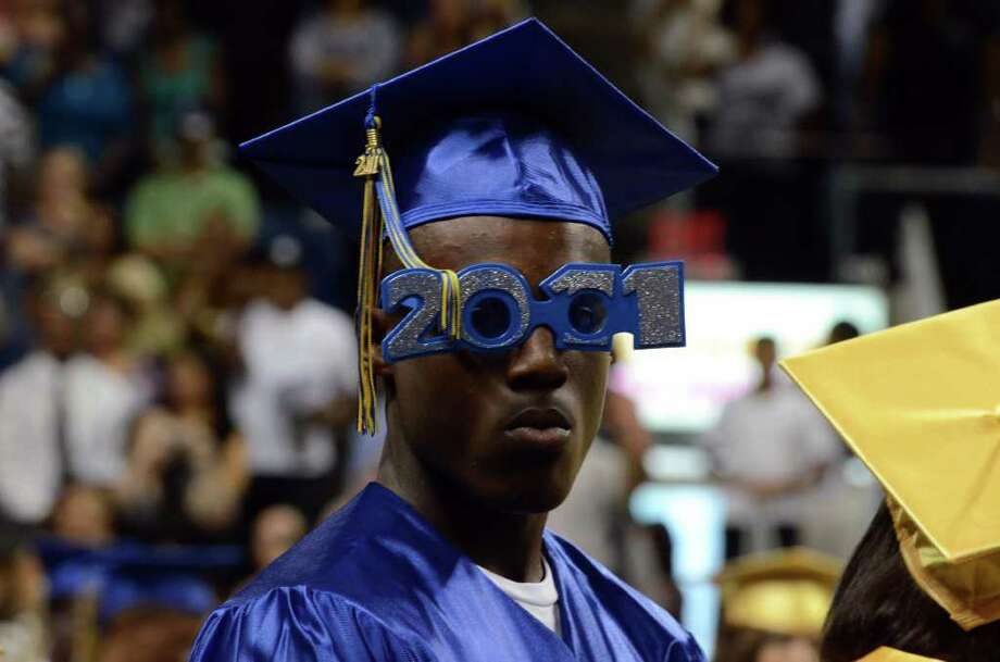 Joseph Spain rocks 2011 shades during the 2011 Warren Harding High School Commencement at Webster Bank Arena in Bridgeport on Monday, June 20, 2011. Photo: Amy Mortensen / Connecticut Post Freelance