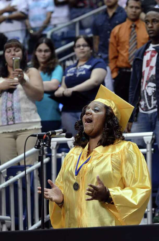A graduate sings the National Anthem during the 2011 Warren Harding High School Commencement at Webster Bank Arena in Bridgeport on Monday, June 20, 2011. Photo: Amy Mortensen / Connecticut Post Freelance