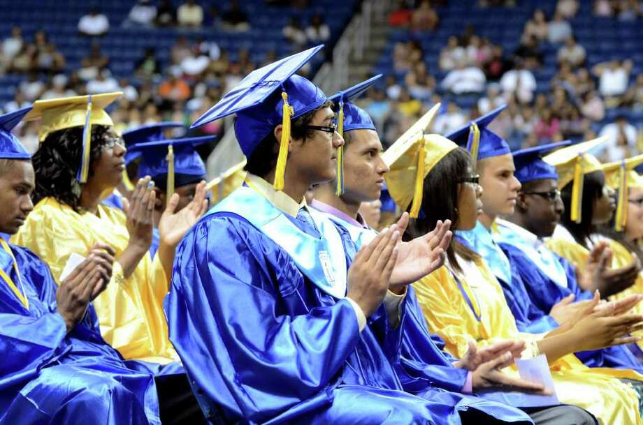 Graduates applaud during the 2011 Warren Harding High School Commencement at Webster Bank Arena in Bridgeport on Monday, June 20, 2011. Photo: Amy Mortensen / Connecticut Post Freelance