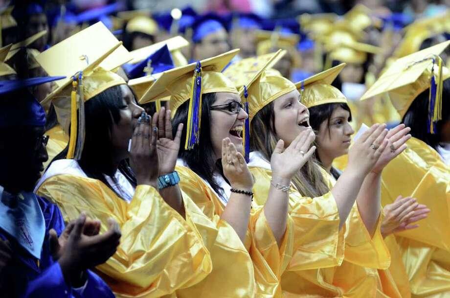 Graduates applaud during the 2011 Warren Harding High School Commencement at Webster Bank Arena in Bridgeport on Monday, June 20, 2011. Photo: Amy Mortensen / Connecticut Post Freelance