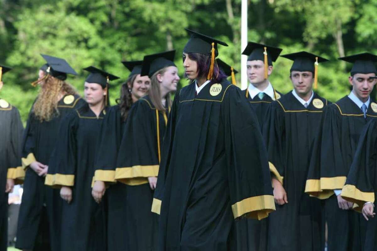 Logan Betso receives his diploma at the Jonathan Law High School Commencement ceremony in Milford on Monday, June, 20, 2011.