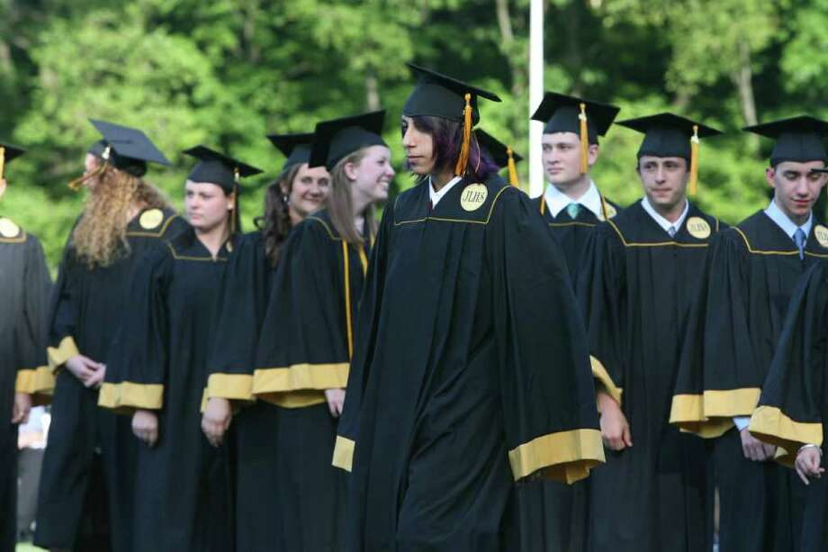 Logan Betso receives his diploma at the Jonathan Law High School Commencement ceremony in Milford on Monday, June, 20, 2011. Photo: B.K. Angeletti / Connecticut Post