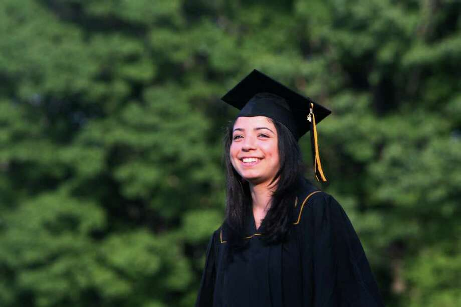 Lizandra Pena receives her diploma at the Jonathan Law High School Commencement ceremony in Milford  on Monday, June, 20, 2011. Photo: B.K. Angeletti / Connecticut Post
