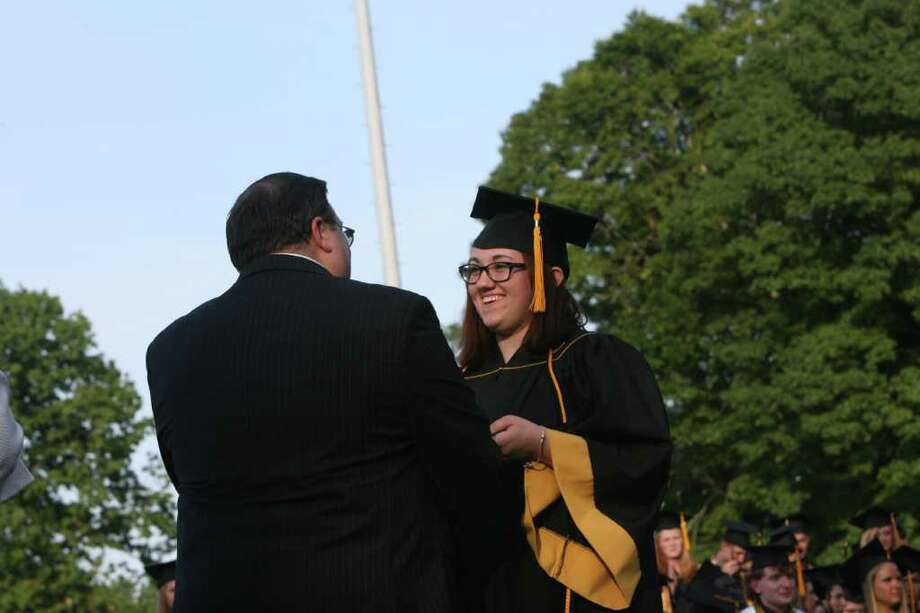 Caitlin Stapleton receives her diploma from her father, Dr Mark Stapleton,  at the Jonathan Law High School Commencement ceremony in Milford  on Monday, June, 20, 2011. Photo: B.K. Angeletti / Connecticut Post