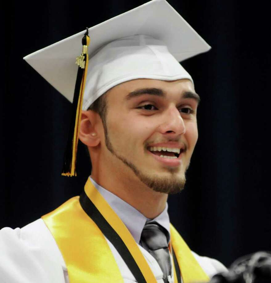 Adam Torres presented a poem he wrote as his speech. Photo: Lisa Weir / The News-Times Freelance