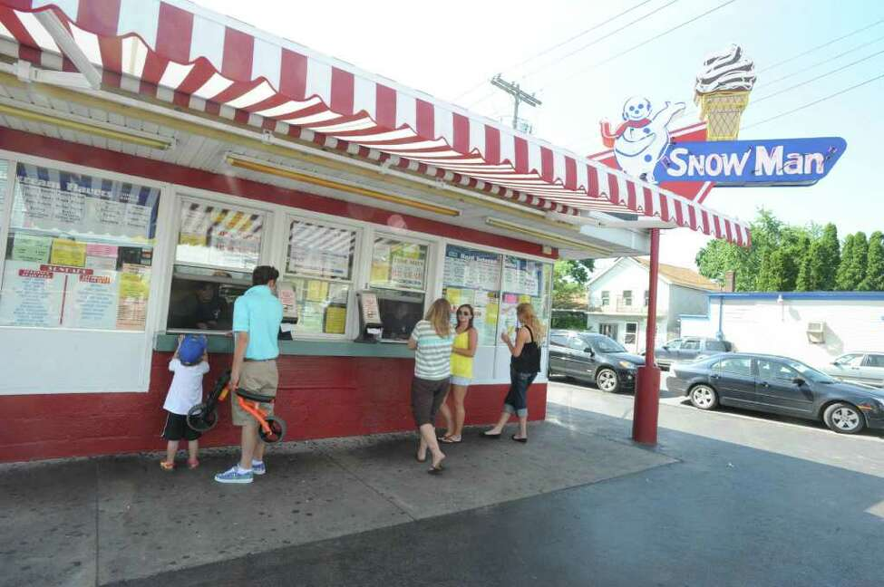 People purchase ice crean at the Snowman ice cream shop in Troy, N.Y. Monday June 20, 2011. (Lori Van Buren / Times Union)