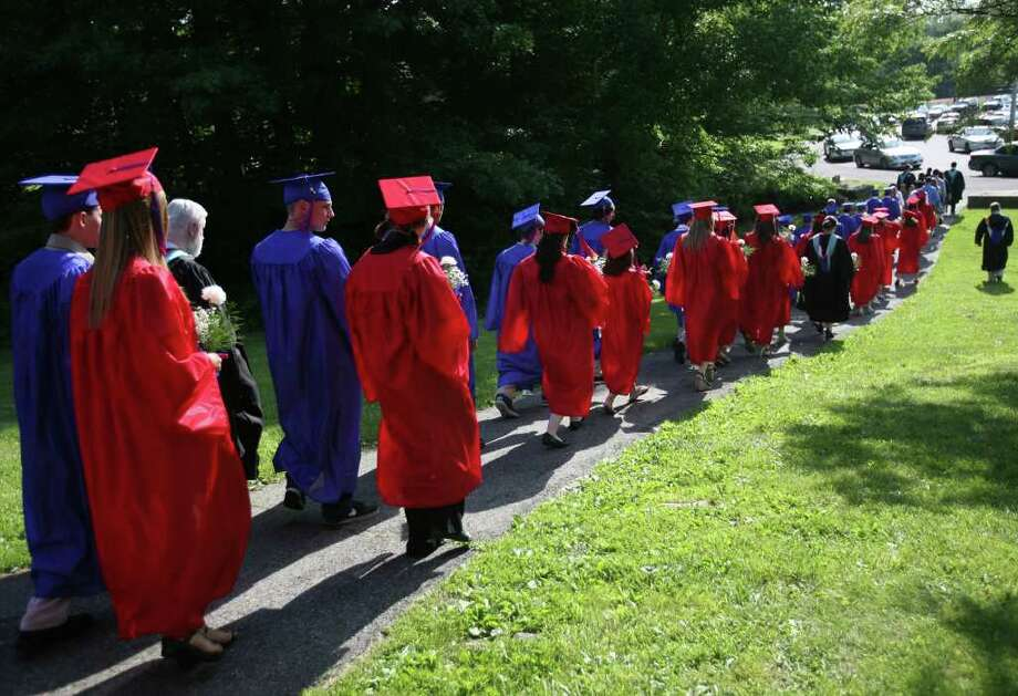 Graduates march down the hill from Foran High School for the Class of 2011 Commencement Exercises in Milford on Monday, June 20, 2011. Photo: Brian A. Pounds / Connecticut Post