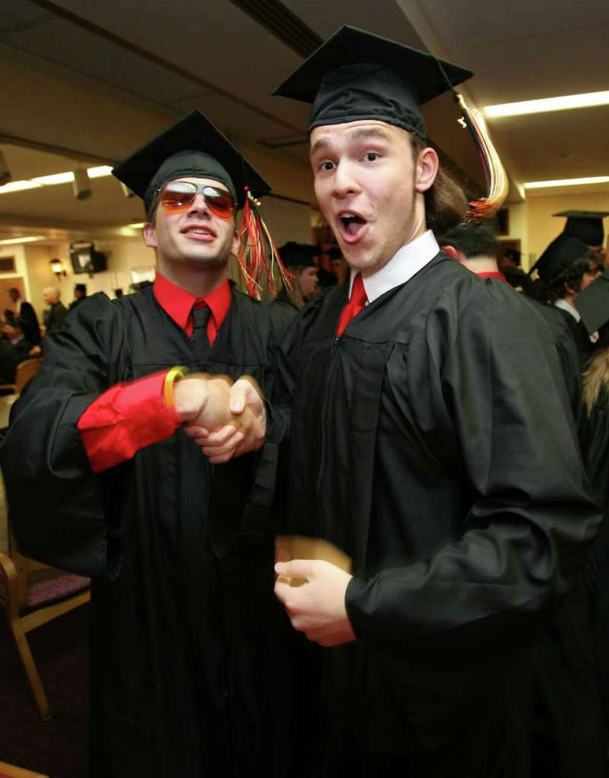 Platt Tech graduation in Milford on Monday, June 20, 2011. Kyle Powers, left of West Haven, and Dennis Pellagrino of Milford.