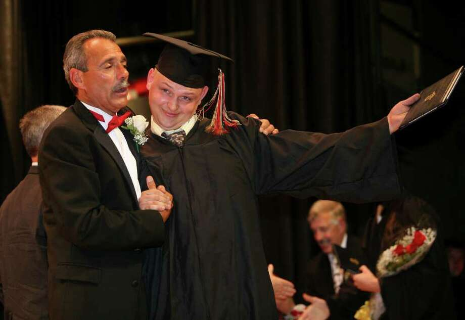 Platt Tech graduation in Milford on Monday, June 20, 2011. Principal Gen LaPorta and graduate Paul Yates of Milford. Photo: Brian A. Pounds / Connecticut Post