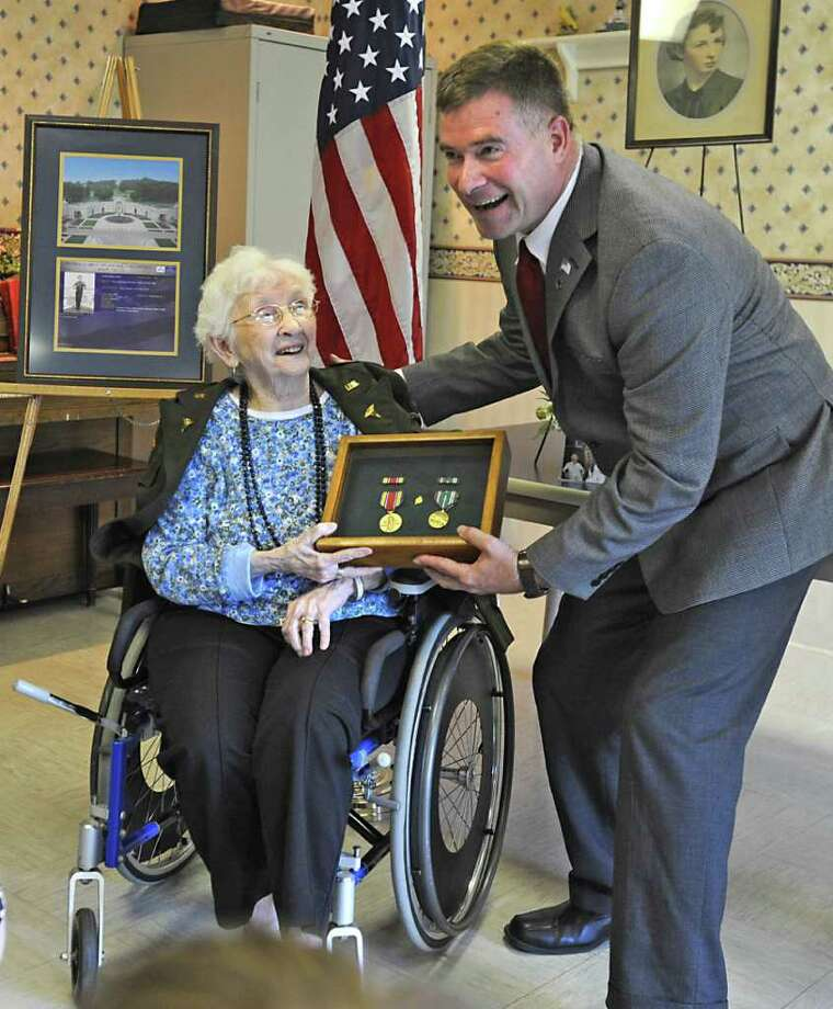 U.S. Rep. Chris Gibson presents three medals to 89-year-old Alice Hargreaves Fay, a former 1st lieutenant in the Army Nurse Corps, at Wesley Health Care Center in Saratoga Springs, N.Y. Monday June 20, 2011.  (Lori Van Buren / Times Union) Photo: Lori Van Buren