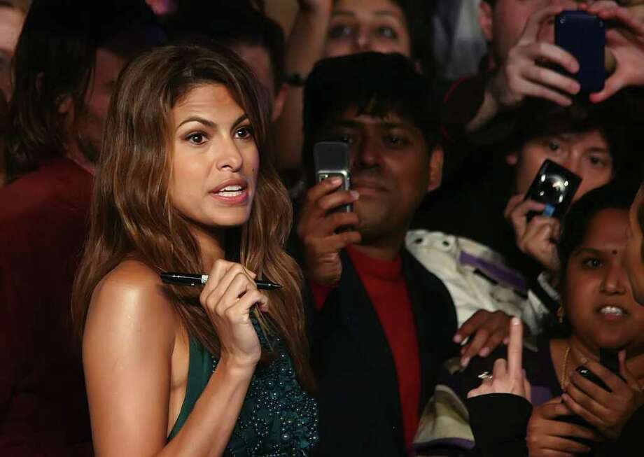 """Actress Eva Mendes signs autographs as she arrives for the British premiere of """"The Other Guys"""" in London's Leicester Square, on September 14, 2010. Parts of the movie were filmed in Albany. (MAX NASH/AFP/Getty Images) Photo: MAX NASH / AFP"""