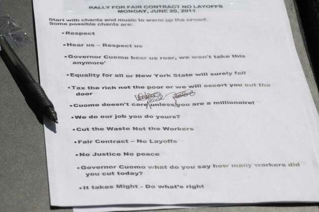 A list of possible chants to lead state workers in is seen taped to the podium during a rally by state workers outside the capitol on Monday afternoon, June 20, 2011 in Albany.   According to the Public Employees Federation union, state workers at 13 locations around the state held rallies on Monday.  The unionized workers were calling on the Governor to negotiate with them and to not layoff workers.  (Paul Buckowski / Times Union) Photo: Paul Buckowski / 00013627A