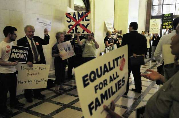 Those against gay marriage and those in support of it filled the hallway outside where Senate Republicans were meeting at the capitol on Monday, June 20, 2011.  Lawmakers returned to work on Monday with issues like gay marriage and property tax cap still unresolved.  (Paul Buckowski / Times Union) Photo: Paul Buckowski  / 00013621A