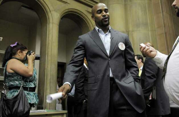 Former NY Giant David Tyree talks to members of the media at the capitol on Monday, June 20, 2011.  Tyree came to Albany to speak out against making gay marriage legal in the state.  (Paul Buckowski / Times Union) Photo: Paul Buckowski  / 00013628A