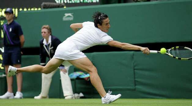 Italy's Francesca Schiavone returns a shot to Australia's Jelena Dokic during their first round match at the All England Lawn Tennis Championships at Wimbledon, Monday, 20 June, 2011. (AP Photo/Anja Niedringhaus) Photo: Anja Niedringhaus