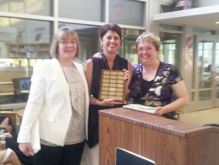Sue Brand, recent chairman of the Board of Education, was honored by the PTA Council on June 1 with the 2011 Deanna O'Kiernan Award. From left to right are Betty Ann O'Shaughnessey, a member of the Fairfield Ludlowe High School PTA; Brand; and Elaine Davis, a member of the PTA Council executive board. Photo: Contributed Photo / Fairfield Citizen contributed
