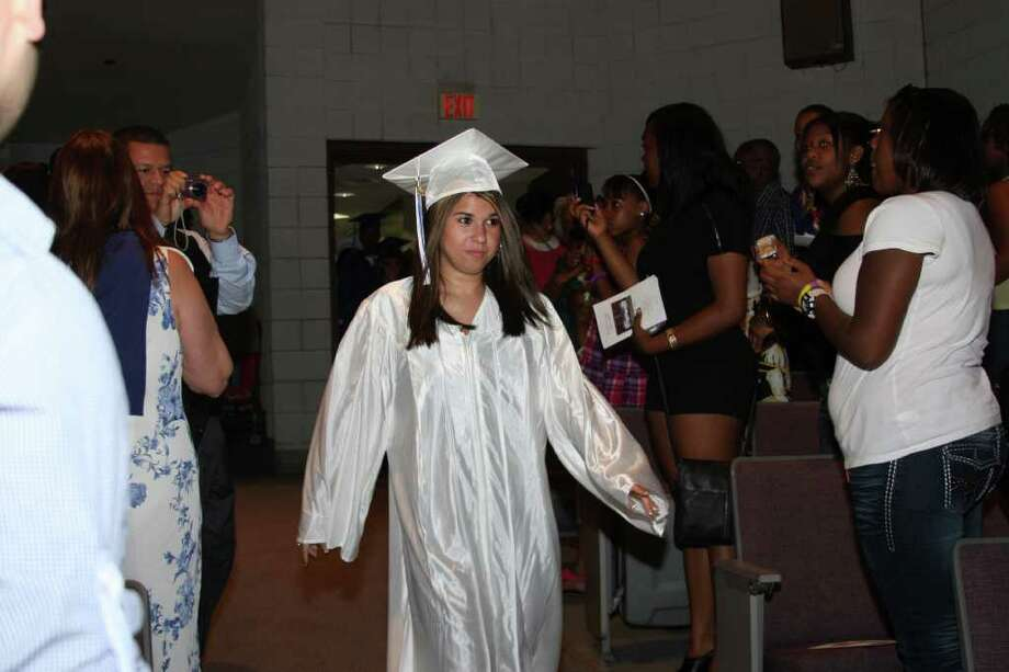 Alyssa Aguiar leads the Richard C. Briggs High School Class of 2011 into the Pepsico Theatre at Norwalk Community College for the graduation ceremony on Monday evening. Photo: Photos By Kristen Riolo, Contributed Photo / Norwalk Citizen