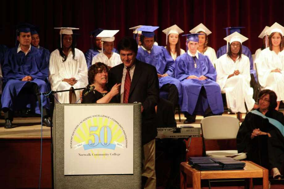 Briggs High School principal Alaine Lane speaks at the graduation ceremony as assistant superintendent Tony Daddona looks on. Lane is retiring this year. Photo: Photos By Kristen Riolo, Contributed Photo / Norwalk Citizen
